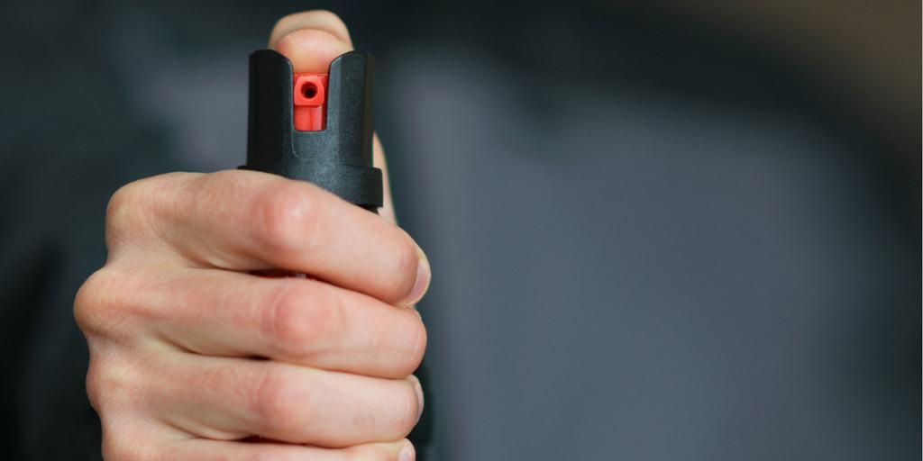 man holding pepper spray