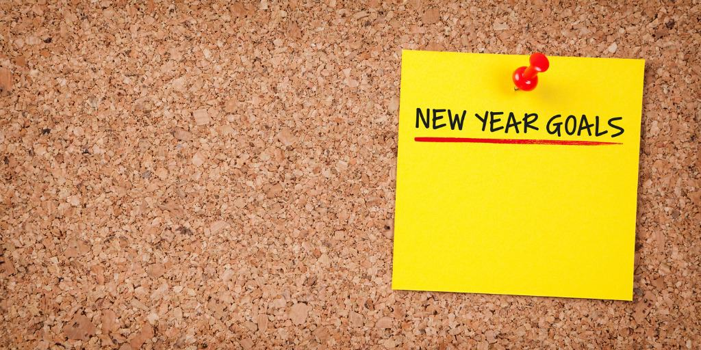 new year's goals sticky note on cork board