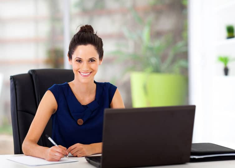 Smiling appraiser sitting at a clean, organized desk