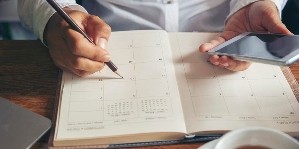 real estate agent making appointments in calendar