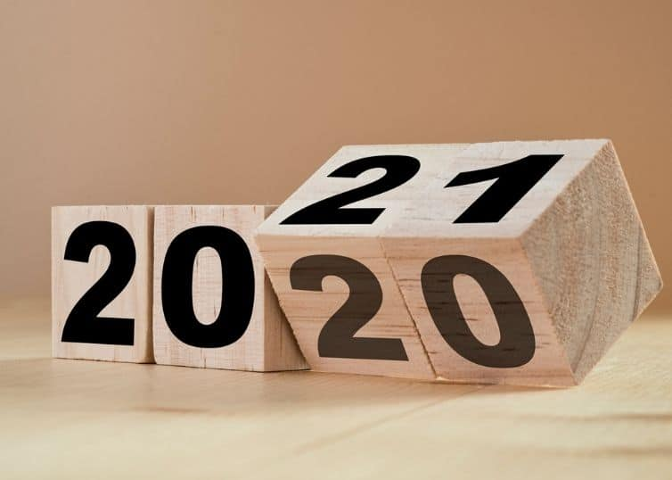 Flipping wooden cubes for new year change 2020 to 2021