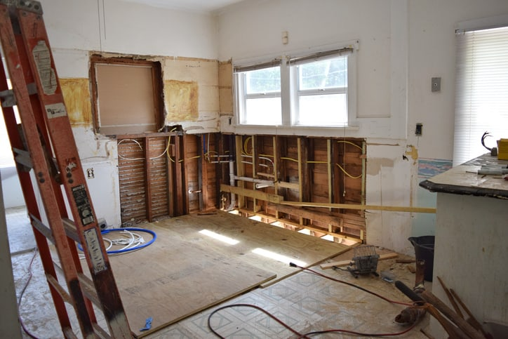 View inside a fixer-upper home, mid-reno, house flipping concept