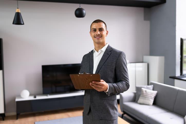 Real Estate Loan Appraiser Man Checking House